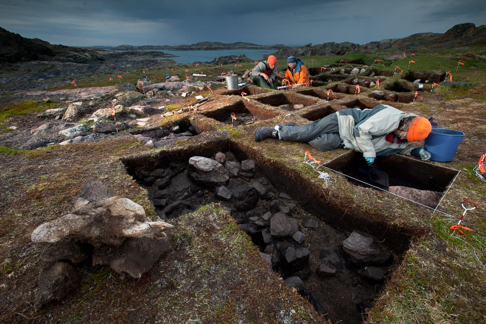Archaeologist Patricia Sutherland (orange jacket) excavates a potential Viking site on Baffin Island. PHOTOGRAPH BY DAVID COVENTRY, NATIONAL GEOGRAPHIC