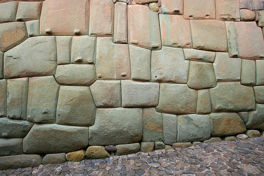 Incan stonework, Palace of Inca Roca, Cuzco, Peru. Another example of extreme precision. Not a single sheet of paper fits between the rocks. Some of theme look as if they were 'fused' together.