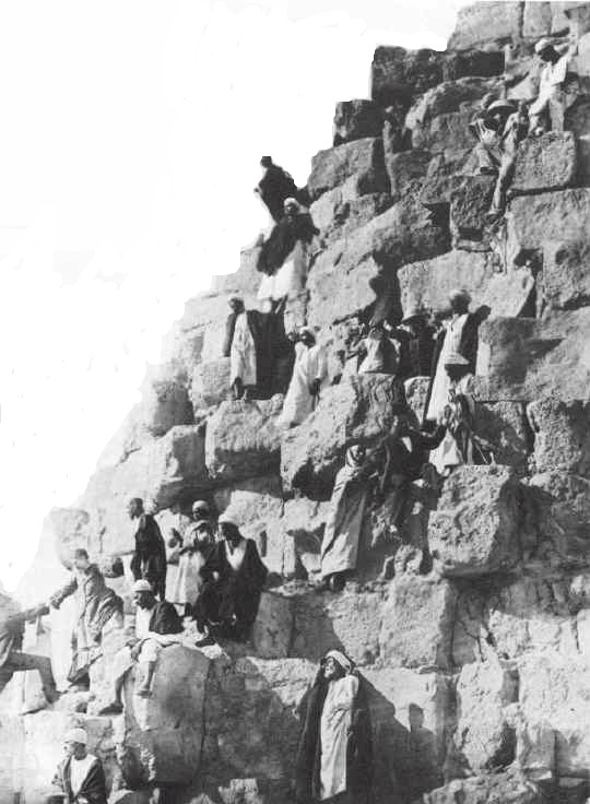 1880s a group of people seen descending the pyramid