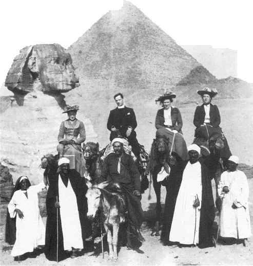 Group of people in front of Sphinx and Pyramid 1885