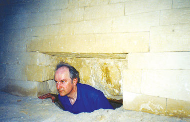 Professor Robert Temple inside a cavities located in the rear part of the Great Sphinx. © Copyright New Dawn Magazine, http://www.newdawnmagazine.com