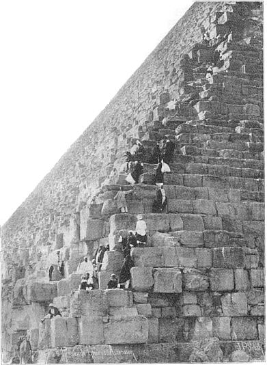 Tourists and guides climbing the Great Pyramid in the early part of the 20th century
