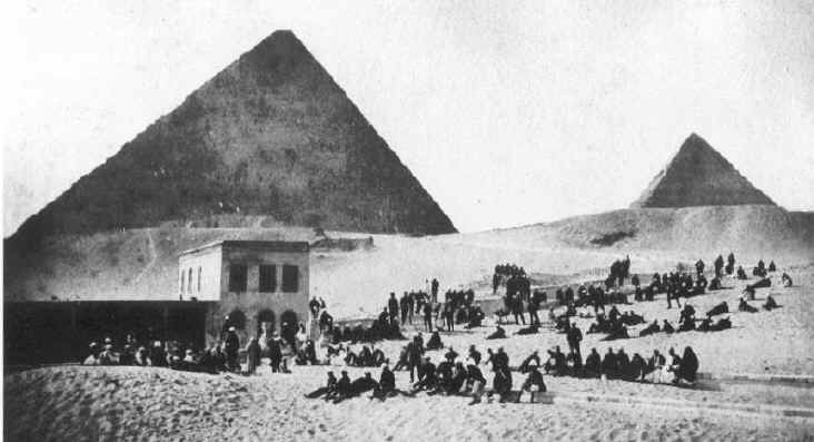 Troops seen in front of the pyramids around 1880