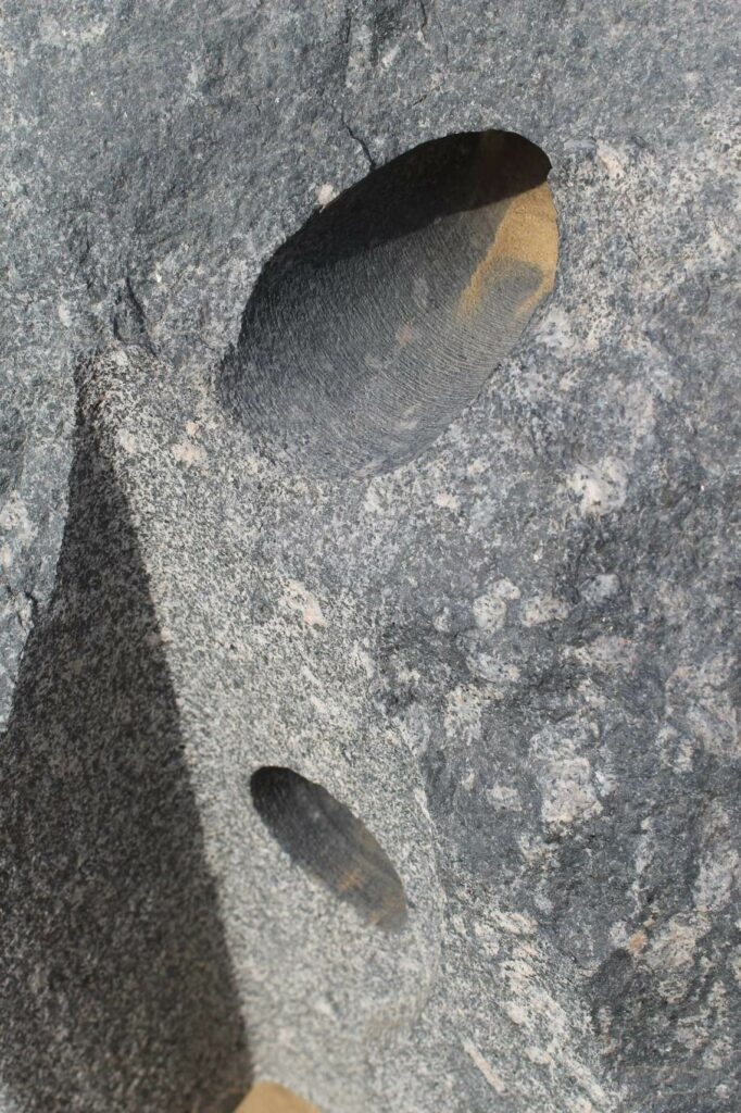 The above photo shows you the marks left by the cutter as it penetrated this black granite located at Abusir. Image Credit