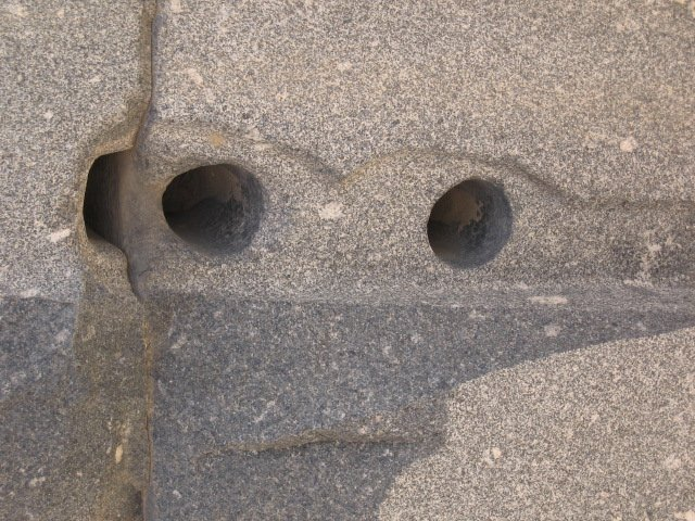 Close-up of holes drilled in granite. Image Credit