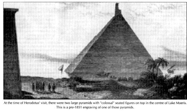At the time of Herodotus visit, there were two large pyramids with colossal seated figures on top in the centre of Lake Moeris.This is a pre-1851 engraving of one of those pyramids