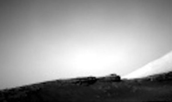 The image taken on Mars depicts what many UFO hunters claim to be the ruins of an alien structure and the doors and even windows are visible.