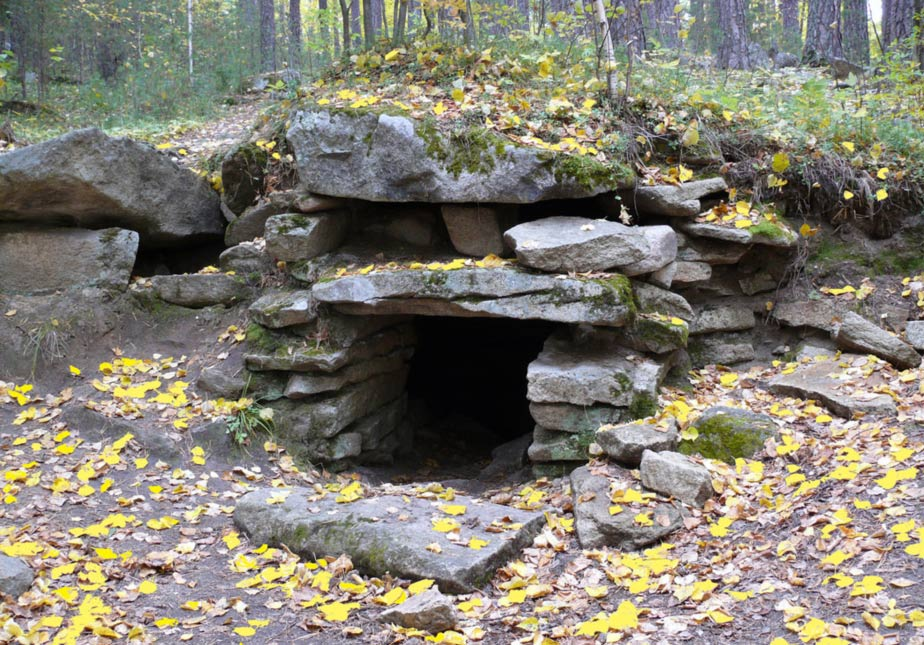 An image of Megalith Structure number 2, it was carved into a rocky slope with a mound structure covering it  Image Credit