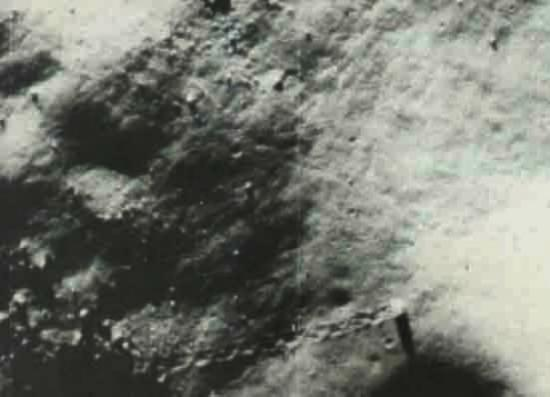 One of the many images of the moon showing objects and paths NOT MADE by man-made vehicles.