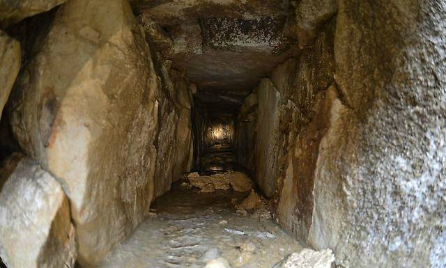 The tunnel, which connects to another, is made of stone and is about 2ft (60cm) wide and tall.