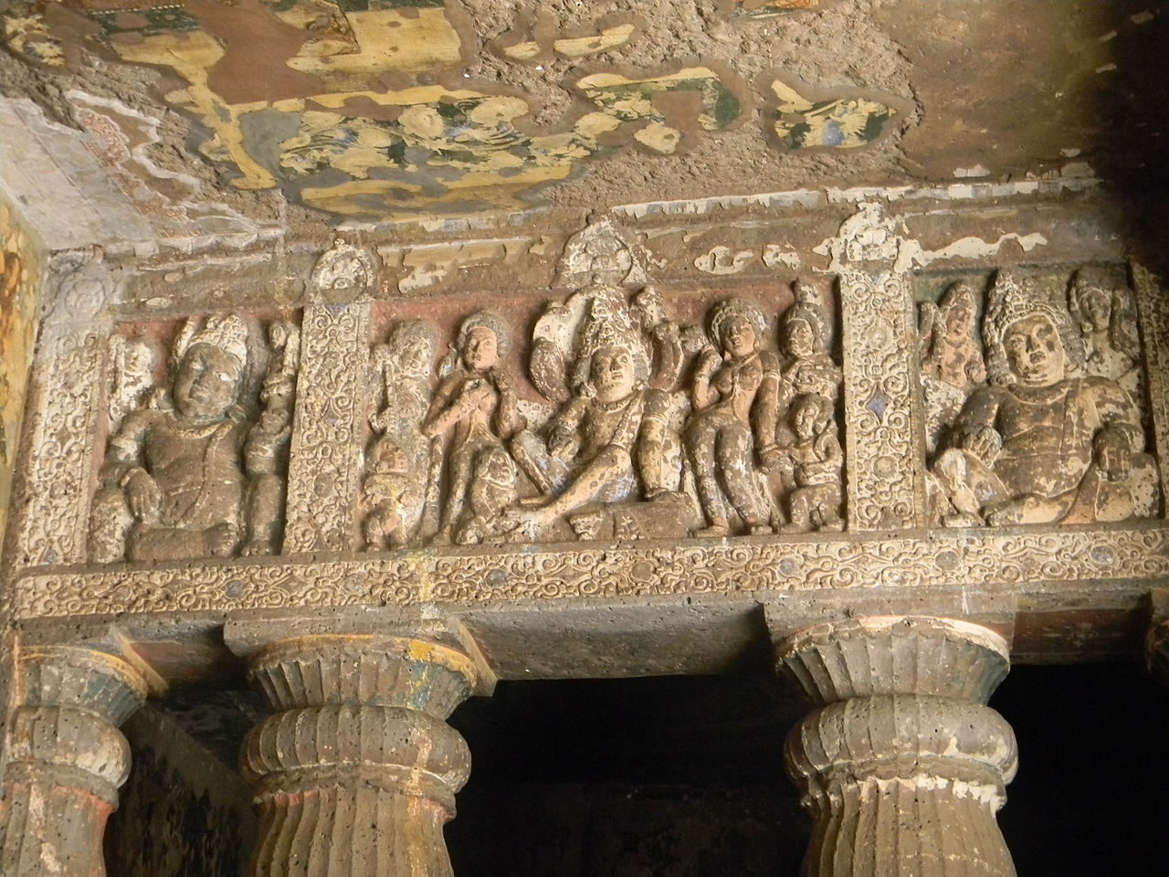 Cave 1, porch: Nagendra panel flanked by yaksa panels