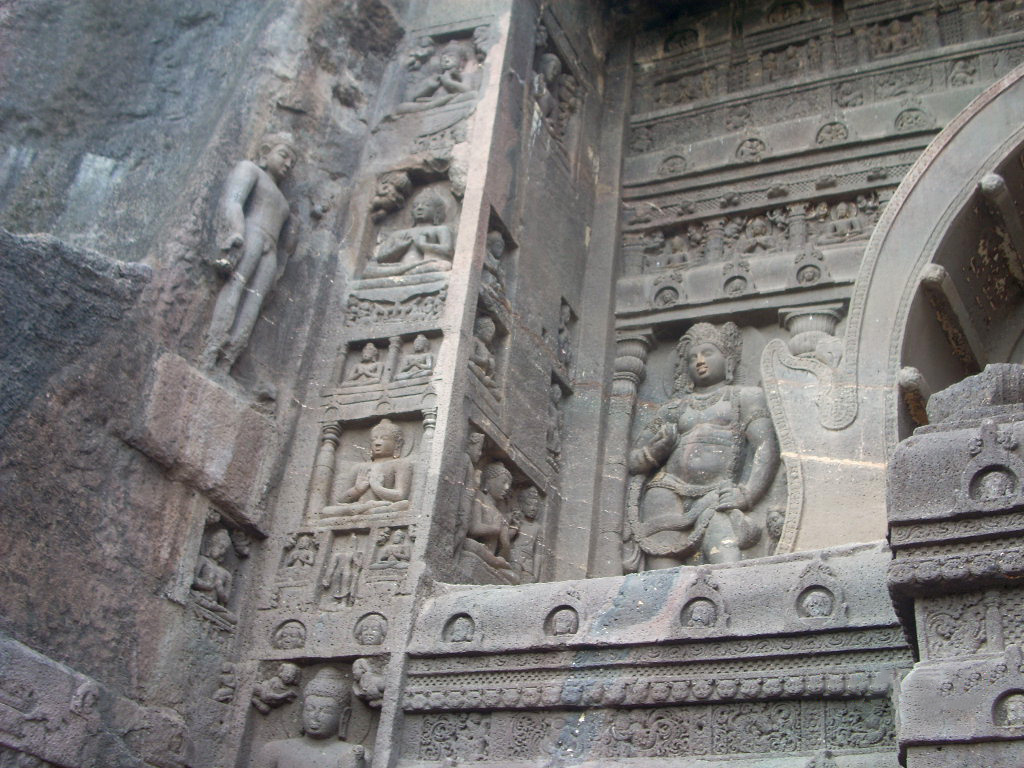 Cave 19 is known for the grandeur of its façade sponsored by king Upendragupta, the standing Buddhas likely intrusively added in 479 CE by others.