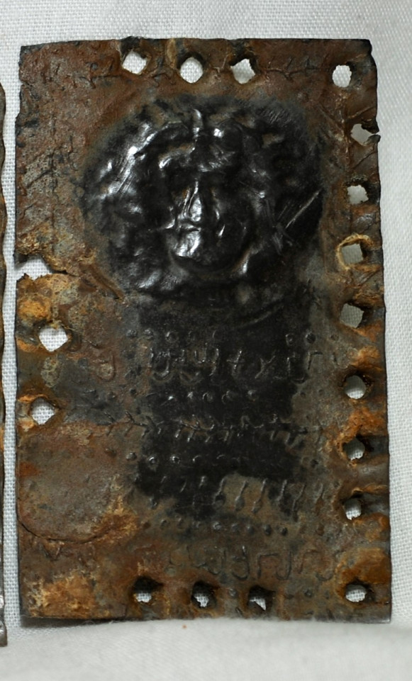 The portrait of Jesus. The metal 'pages' are held together like a ring binder and were found in Jordan in 2008.