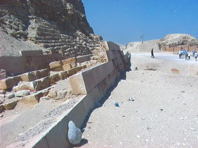 Not all of the casing stones are missing. A few of the casing stones from the lowest course can be seen to around the base of the Great Pyramid. Image Credit.