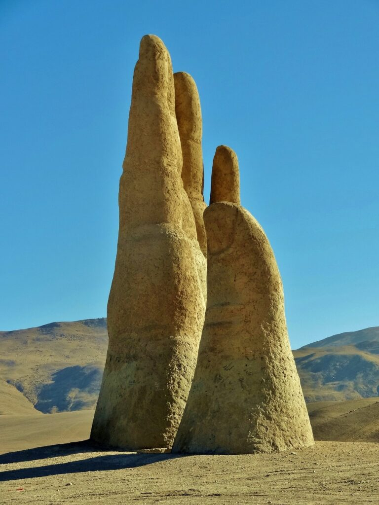 The Atacama desert of Chile hides a MASSIVE hand protruding from the ground 11861233913_aa562bbde5_o-768x1024