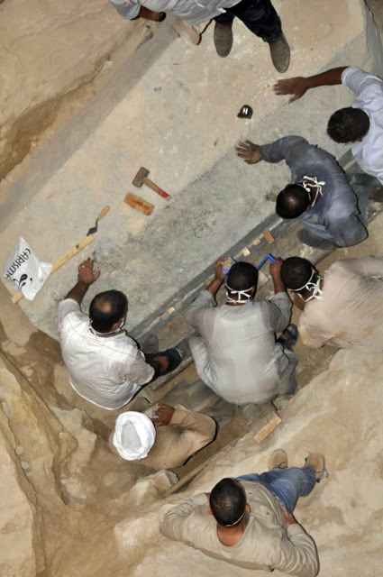 Experts opening a granite sarcophagus discovered in Alexandria.