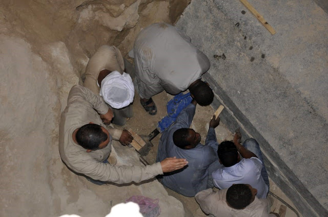 Experts opening a sarcophagus discovered buried in Alexandria, Egypt.
