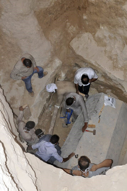 Researchers working on the granite sarcophagus found in Alexandria.