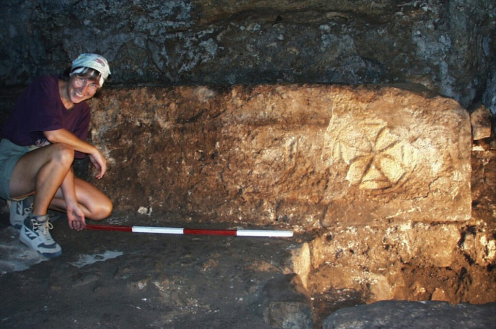 An Archaeologist performing excavations.