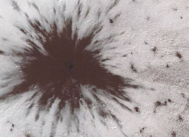 Something So Big Collided Against Mars, It Smashed Through Mars' Ice Cap, And NASA Has Images
